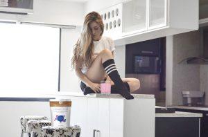 rejuvenated collagen shots woman in the kitchen